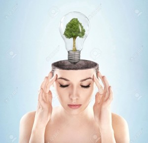 9234005-Open-minded-woman-with-green-energy-symbol-Stock-Photo-energy-think-concept