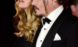 Johnny Depp îşi vinde lucrările sale scoţându-le la licitație, în anticiparea divorțului