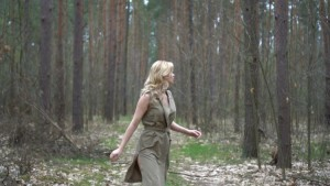blonde-woman-in-the-forest-running-horror-movie-scene_huggnxwn__F0000